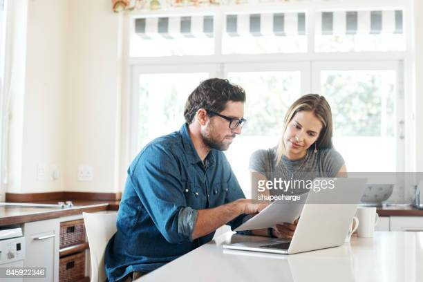 evaluating their income and expenditure - young couple stock pictures, royalty-free photos & images