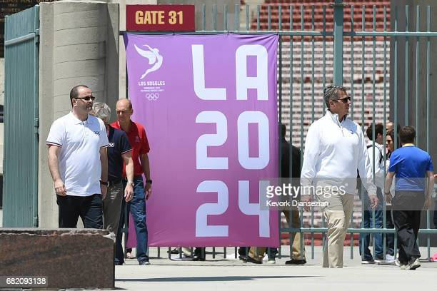 Evaluation Commission Chairman Patrick Baumann and LA 2024 Chairman Casey Wasserman tour the Los Angeles Memorial Coliseum May 11 in Los Angeles...