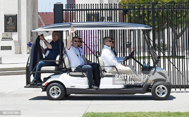 Evaluation Commission Chairman Patrick Baumann waves at the media as he leaves with LA 2024 Chairman Casey Wasserman after touring Los Angeles...
