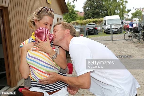 EvaMaria Grein and her husband Christoph von Friedl and their baby son Jonathan during the charity football game 'Kick for Kids' to benefit 'Die...