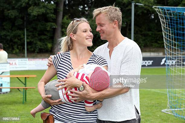 Eva-Maria Grein and her husband Christoph von Friedl and their baby son Jonathan during the charity football game 'Kick for Kids' to benefit 'Die...