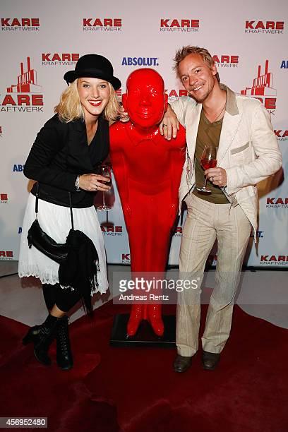 Eva-Maria Grein von Friedl and Christoph von Friedl attend the Grand opening of KARE Kraftwerk store on October 9, 2014 in Munich, Germany.