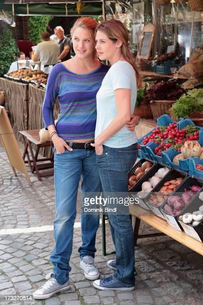 Eva-Maria Grein von Friedl and Felicitas Woll pose during the TV production of 'Von Kerlen und Kuehen' on July 11, 2013 in Munich, Germany.
