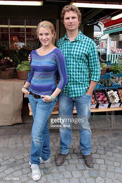 Eva-Maria Grein von Friedl and Leonhard Reisinger pose during the TV production of 'Von Kerlen und Kuehen' on July 11, 2013 in Munich, Germany.