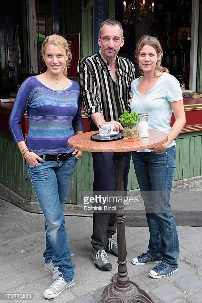 Eva-Maria Grein von Friedl, Heio von Stetten and Felicitas Woll pose during the TV production of 'Von Kerlen und Kuehen' on July 11, 2013 in Munich,...