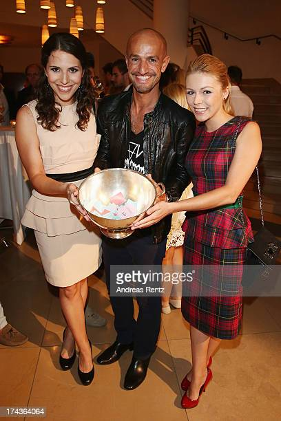 Eva-Maria Reichert, Peyman Amin and Anna Ewelina attend the Marcel Ostertag fashion show at Charles Hotel on July 24, 2013 in Munich, Germany.