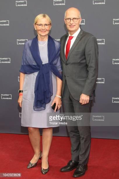 Eva-Maria Tschentscher and Peter Tschentscher attend the opening of the Hamburg Film Festival 2018 on September 27, 2018 in Hamburg, Germany.