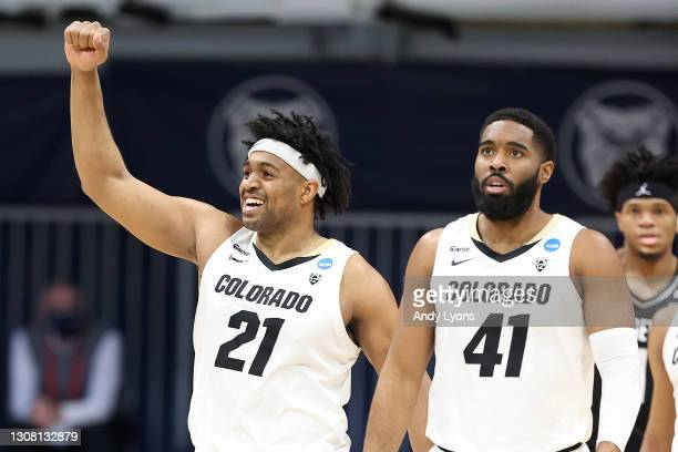 Evan Battey and Jeriah Horne of the Colorado Buffaloes react to a play against the Georgetown Hoyas in the first round game of the 2021 NCAA Men's...