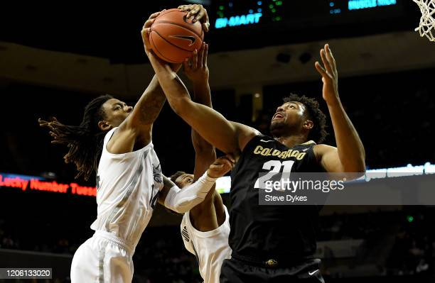 Evan Battey of the Colorado Buffaloes and C.J. Walker of the Oregon Ducks battle for a rebound during the second half at Matthew Knight Arena on...