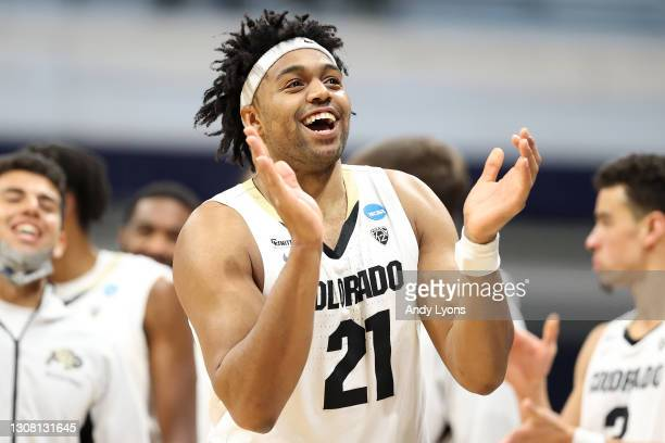 Evan Battey of the Colorado Buffaloes celebrates at the end of their first round win against the Georgetown Hoyas in the 2021 NCAA Men's Basketball...