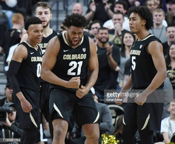 Evan Battey of the Colorado Buffaloes reacts after hitting a shot and getting a foul call against the Oregon State Beavers during a quarterfinal game...