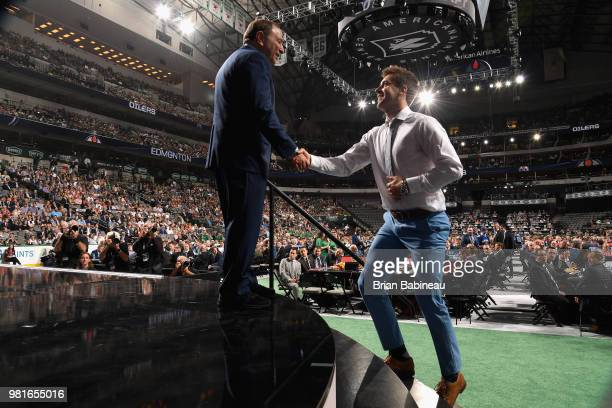 Evan Bouchard greets NHL commissioner Gary Bettman after being selected tenth overall by the Edmonton Oilers during the first round of the 2018 NHL...