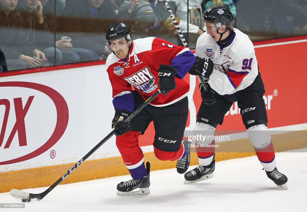 Evan Bouchard #2 of Team Cherry skates with the puck against Ryan McLeod #91 Team Orr in the 2018 Sherwin-Williams CHL/NHL Top Prospects game at the Sleeman Centre on January 25, 2018 in Guelph, Ontario, Canada. Team Cherry defeated Team Orr 7-4.