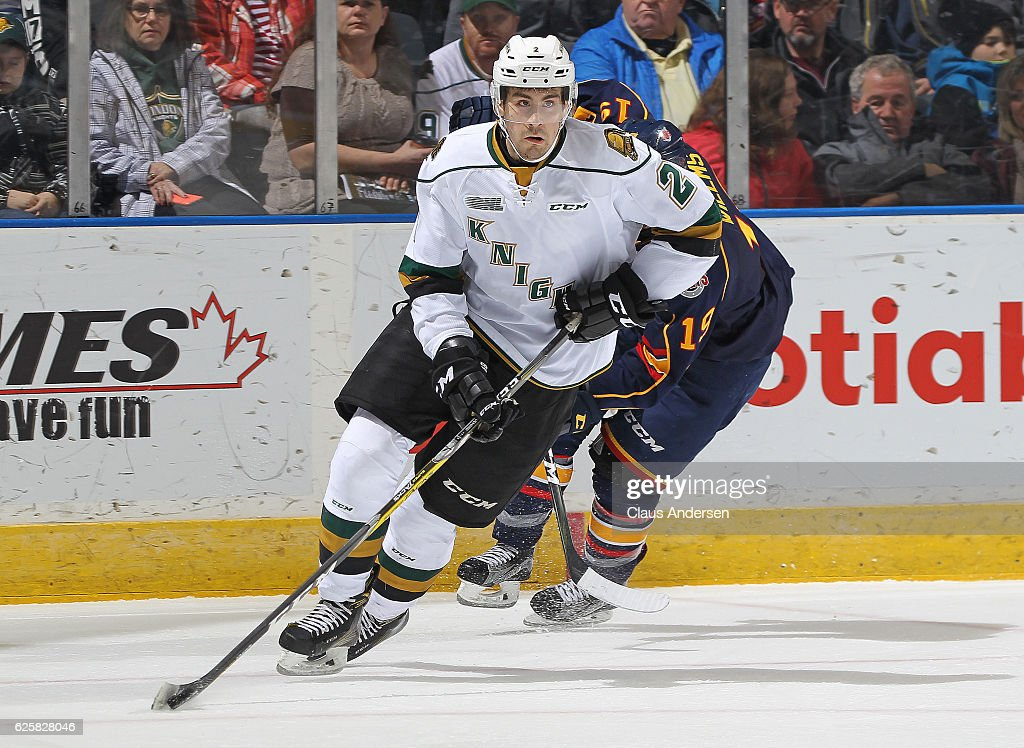 Evan Bouchard #2 of the London Knights skates away with the puck against the Barrie Colts during an OHL game at Budweiser Gardens on November 25, 2016 in London, Ontario, Canada. The Knights defeated the Colts 4-1.