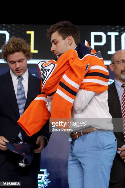 Evan Bouchard poses after being selected tenth overall by the Edmonton Oilers during the first round of the 2018 NHL Draft at American Airlines...
