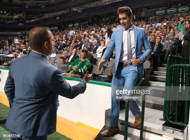 Evan Bouchard walks down the stairs after being selected tenth overall by the Edmonton Oilers during the first round of the 2018 NHL Draft at...