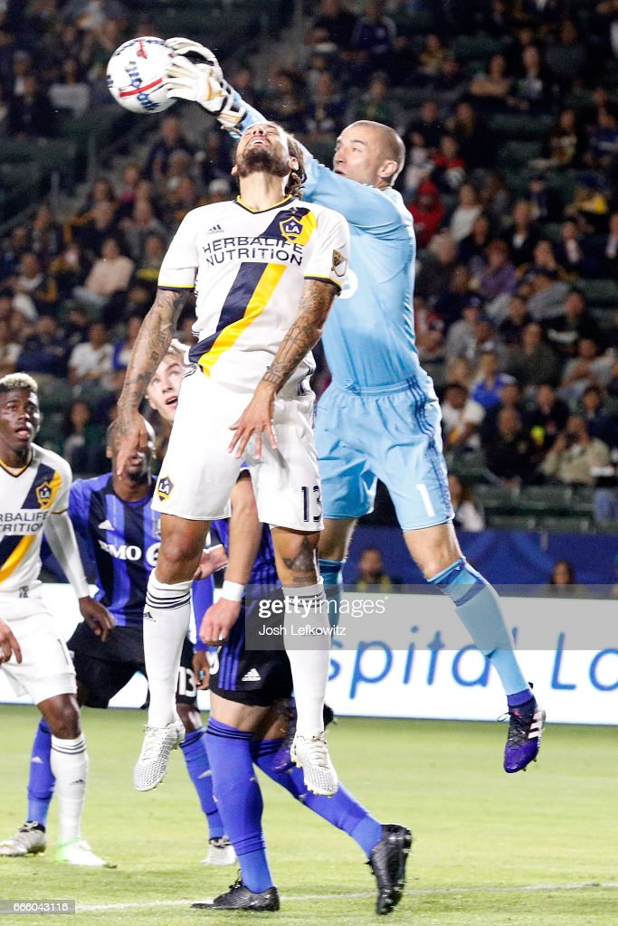 Evan Bush #1 of Montreal Impact grabs the ball as Jermaine Jones #13 of Los Angeles Galaxy tries to get on the end of a cross during Los Angeles Galaxy's MLS match against Montreal Impact at the StubHub Center on April 7, 2017 in Carson, California.