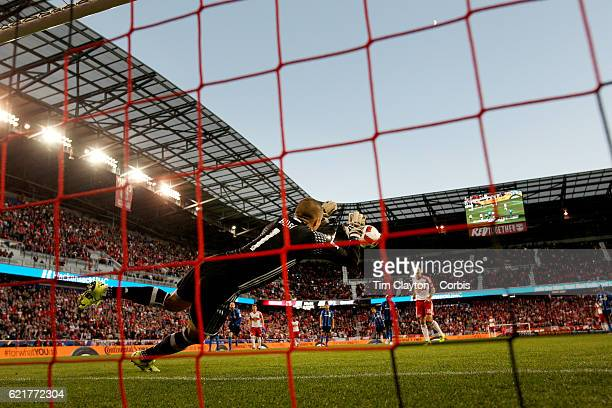 Evan Bush of Montreal Impact saves a penalty kick from Sacha Kljestan of New York Red Bulls during the New York Red Bulls Vs Montreal Impact MLS...