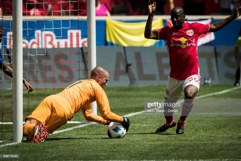 Evan Bush #1 of Montreal Impact stops the shot on goal by Bradley Wright-Phillips #99 of New York Red Bulls during the Major League Soccer match between Montreal Impact and New York Red Bulls at Red Bull Arena on April 14, 2018 in Harrison, NJ. The New York Red Bulls won the match with a score of 3 to 1.