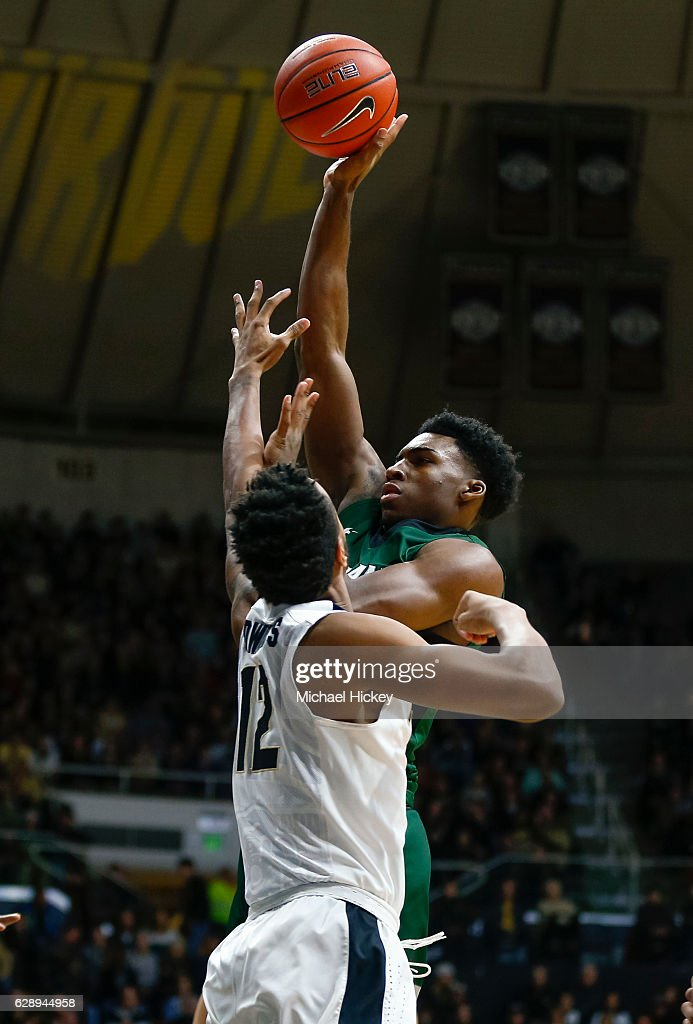Evan Clayborne #22 of the Cleveland State Vikings shoots the ball against Vince Edwards #12 of the Purdue Boilermakers at Mackey Arena on December 10, 2016 in West Lafayette, Indiana.