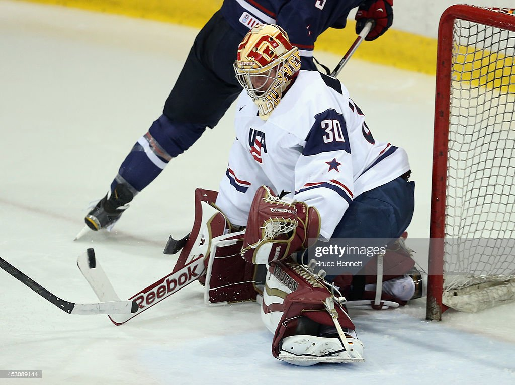 Evan Cowley #30 of USA White tends net against USA Blue during the 2014 USA Hockey Junior Evaluation Camp at Lake Placid Olympic Center on August 2, 2014 in Lake Placid, New York.
