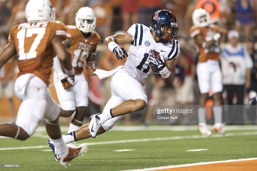 Evan Engram #17 of the Mississippi Rebels breaks free for a 17 yard touchdown against the Texas Longhorns on September 14, 2013 at Darrell K Royal-Texas Memorial Stadium in Austin, Texas.