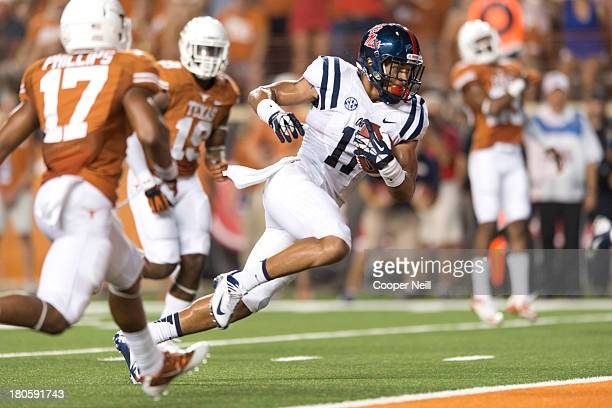 Evan Engram of the Mississippi Rebels breaks free for a 17 yard touchdown against the Texas Longhorns on September 14, 2013 at Darrell K Royal-Texas...