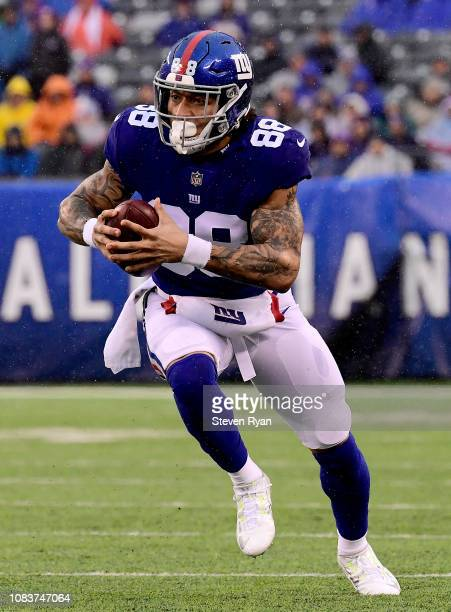 Evan Engram of the New York Giants carries the ball after a reception against the Tennessee Titans at MetLife Stadium on December 16 2018 in East...