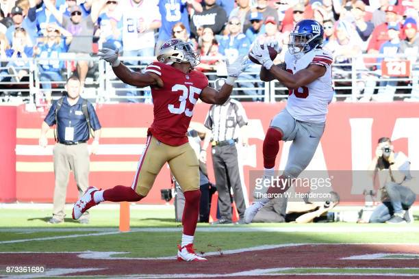 Evan Engram of the New York Giants catches a nineyard touchdown against the San Francisco 49ers during their NFL game at Levi's Stadium on November...