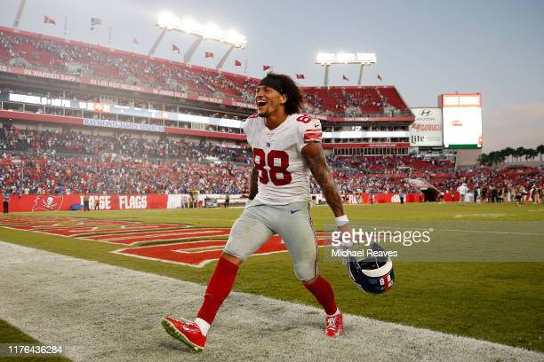Evan Engram of the New York Giants celebrates after defeating the Tampa Bay Buccaneers 3231 at Raymond James Stadium on September 22 2019 in Tampa...