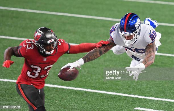 Evan Engram of the New York Giants comes up short as he dives for the end zone against Jordan Whitehead of the Tampa Bay Buccaneers in the first half...