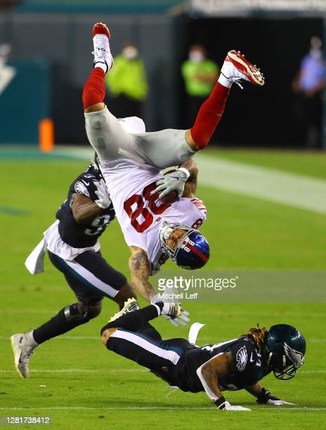 Evan Engram of the New York Giants flips over Cre'von LeBlanc of the Philadelphia Eagles as Josh Sweat during the third quarter defends at Lincoln...