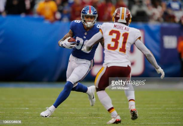 Evan Engram of the New York Giants in action against Fabian Moreau of the Washington Redskins on October 28 2018 at MetLife Stadium in East...