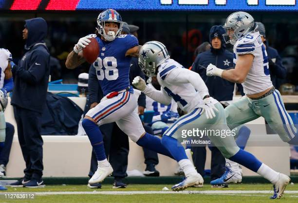 Evan Engram of the New York Giants in action against the Dallas Cowboys on December 30 2018 at MetLife Stadium in East Rutherford New Jersey The...