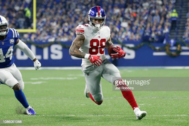 Evan Engram of the New York Giants runs the ball in the game against the Indianapolis Colts in the first quarter at Lucas Oil Stadium on December 23...