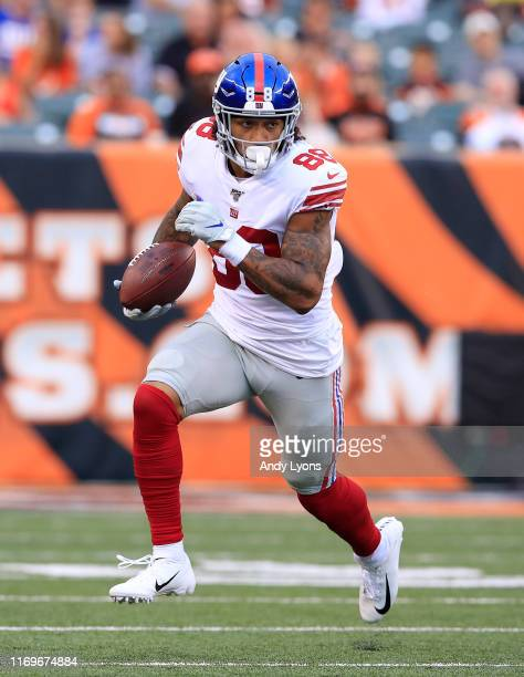 Evan Engram of the New York Giants runs with the ball against the Cincinnati Bengals at Paul Brown Stadium on August 22 2019 in Cincinnati Ohio