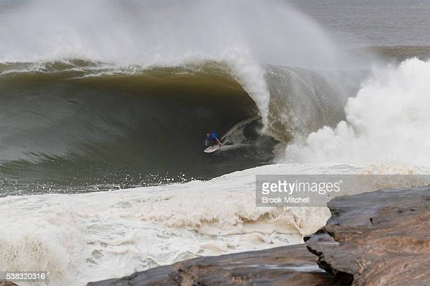 Evan Faulks rides a monster wave during the Cape Fear contest on June 6 2016 in Sydney Australia