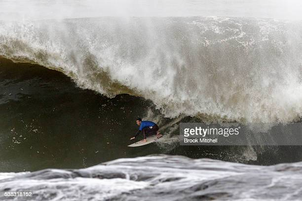 Evan Faulks rides a waves during Cape Fear on June 6 2016 in Sydney Australia
