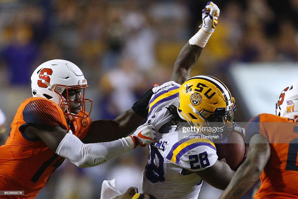 Evan Foster #14 of the Syracuse Orange tackles Darrel Williams #28 of the LSU Tigers during the second half of a game at Tiger Stadium on September 23, 2017 in Baton Rouge, Louisiana.