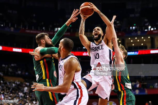Evan Fournier of France drives against Jonas Valanciunas of Lithuania during 2nd round Group L match between France and Lithuania of 2019 FIBA World...