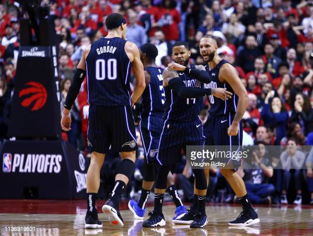 Evan Fournier and Aaron Gordon celebrate with DJ Augustin of the Orlando Magic after Augustin hit the game winning shot during Game One of the first...