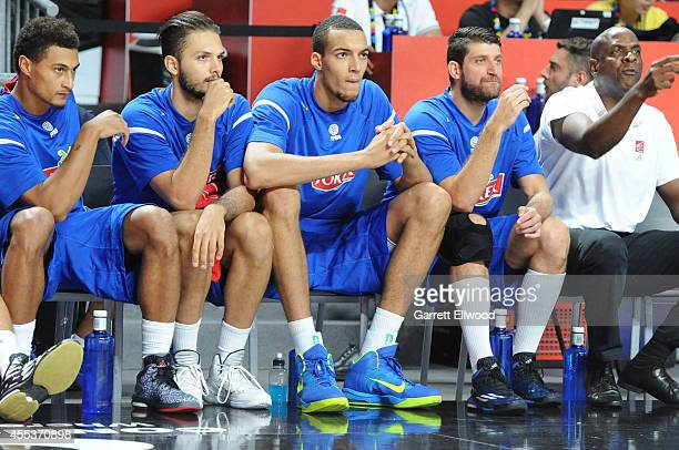 Evan Fournier and Rudy Gobert of the France National Team looks on against the Lithuania National Team during the 2014 FIBA World Cup Third Place...
