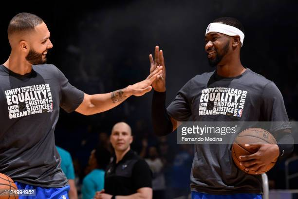 Evan Fournier and Terrence Ross of the Orlando Magic high five before the game against the Charlotte Hornets on February 14 2019 at Amway Center in...