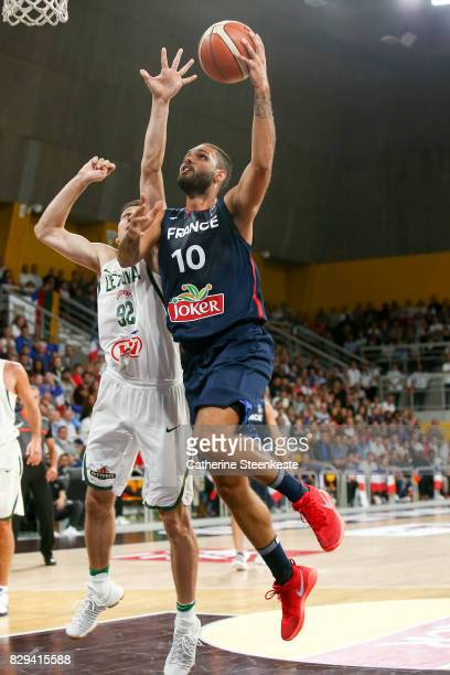 Evan Fournier of France is at the basket against Edgaras Ulanovas of Lithuania during the international friendly game between France v Lithuania at...