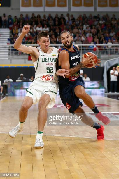 Evan Fournier of France is driving to the basket against Edgaras Ulanovas of Lithuania during the international friendly game between France v...