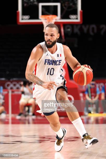 Evan Fournier of Team France drives to the basket against Team United States of America during the first half of the Men's Preliminary Round Group B...