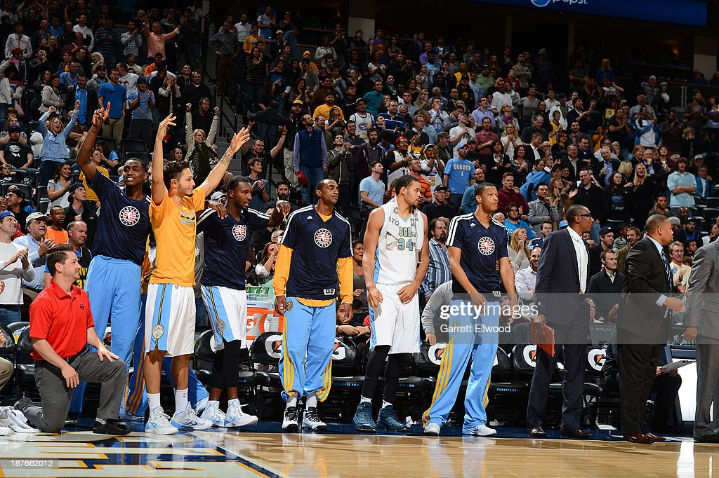 Evan Fournier #94 of the Denver Nuggets and the bench celebrate during the game against the Atlanta Hawks on November 7, 2013 at the Pepsi Center in Denver, Colorado.