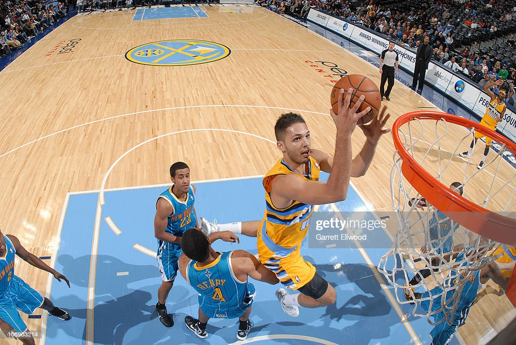 Evan Fournier #94 of the Denver Nuggets goes to the basket during the game between the New Orleans Hornets and the Denver Nuggets on November 25, 2012 at the Pepsi Center in Denver, Colorado.
