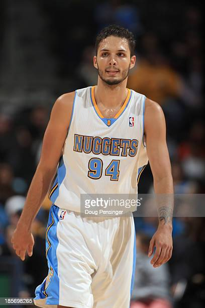 Evan Fournier of the Denver Nuggets plays against the Phoenix Suns during preseason action at Pepsi Center on October 23 2013 in Denver Colorado The...