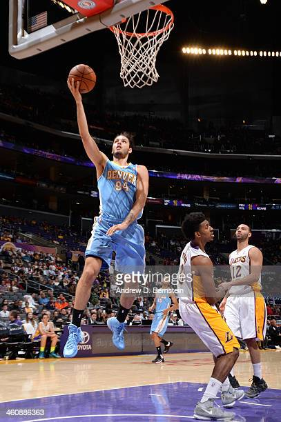 Evan Fournier of the Denver Nuggets shoots during a game against the Los Angeles Lakers at STAPLES Center on January 5 2014 in Los Angeles California...